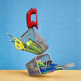 Office supplies soar on air in conditions of zero gravity. Royalty Free Stock Photos