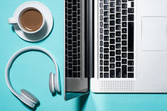 Office supplies. Top view on laptop, headphone and cup of coffee Royalty Free Stock Photography