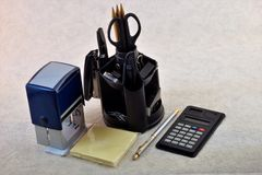 Office supplies. Supplies used for correspondence and processing of paper documents. Calculator pen pencil sticker paper clip stapler folder ruler compass stock image
