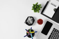 Top view of white office desk with office supplies. Office supplies on white office desk. Minimal simplicity flat lay with copy space Stock Photo