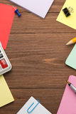Office supplies on wood Royalty Free Stock Image