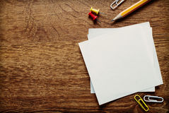 Office Supplies on Wooden Surface with Copy Space Stock Image