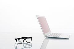 Office supplies. Writing instruments, glasses, memory stick and touchpad royalty free stock images