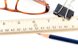 Office supply. Pencil ruler clip and glasses on the desk Stock Photos