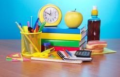 Office supply, alarm clock and calculator Stock Images