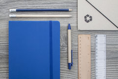 Office supply. Collection - pencils, ball pen, folder, notebook and rulers - on brown wooden table Royalty Free Stock Images