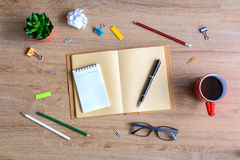Office supply and Cup of coffee on desk Stock Photography