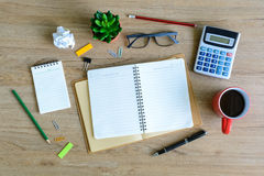 Office supply and Cup of coffee on desk Royalty Free Stock Photos