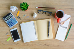 Office supply and Cup of coffee on desk Stock Images