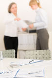 Office supply - two business women discussing Stock Photos