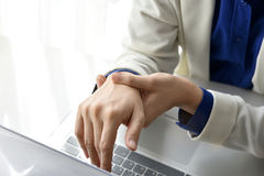 Office syndrome hand pain by occupational disease. Office syndrome hand pain by occupational disease, Closeup business woman with wrist pain, Woman holding her royalty free stock images