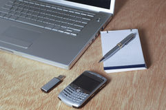Office table. With laptop, cellphone, pen drive and pen Stock Photo