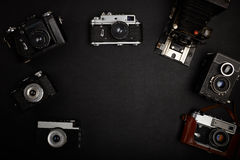 Office table with accessories. Vintage film camera on office table. Top view Royalty Free Stock Photos