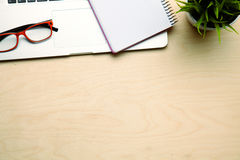 Office table with blank notepad and laptop Royalty Free Stock Images