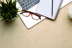 Office table with blank notepad and laptop Royalty Free Stock Photography