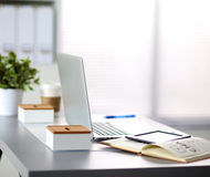Office table with blank notepad and laptop Stock Image