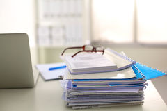 Office table with blank notepad and laptop Stock Photos