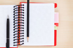 Office table with blank notepad, pen and pencil Stock Photos