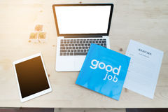 Office table with blank screen of  laptop, tablet and resume inf Royalty Free Stock Images