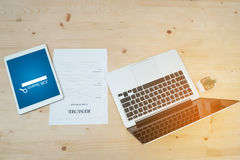 Office table with blank screen of  laptop, tablet and resume inf Royalty Free Stock Photos