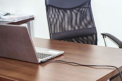 Workplace with notebook laptop .The office, in the office table and chair, on the table is a computer connected to the network royalty free stock photography