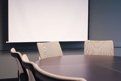 Office table with chairs. Training room with chairs and a screen Stock Photos