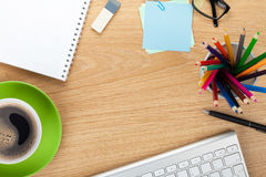 Office table with coffee cup and supplies Royalty Free Stock Photography
