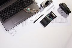 Office table with computer, calculator and glasses. Top view royalty free stock images