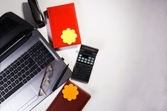 Office table with computer, calculator and glasses. Top view royalty free stock photos