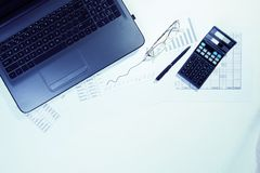 Office table with computer, calculator and glasses. Top view stock photos