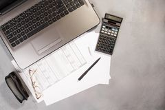 Office table with computer and calculator. Top view royalty free stock photo