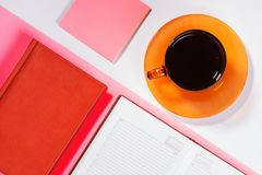 Office table with cup of coffee. Colour. Flat lay top view royalty free stock photos