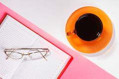 Office table with cup of coffee and glasses. Colour. Flat lay top view stock image