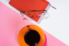 Office table with cup of coffee and glasses. Colour. Flat lay top view royalty free stock photos