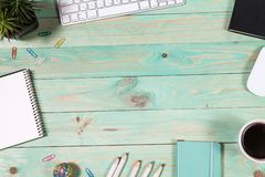 Office table desk with set of colorful supplies. Blue office desk table with with office supplies. Top view with copy space Royalty Free Stock Image