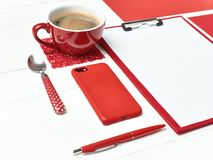 Office table desk with set of colorful supplies, white blank note pad, cup, pen on white background. Stock Image