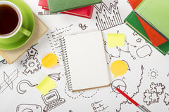 Office table desk with supplies, blank note pad, cup, pen on white background of business strategy. Top view copy space Stock Photography