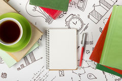 Office table desk with supplies, blank note pad, cup, pen on white formula background of business strategy. Top view Stock Photography