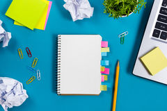 Free Office Table Desk With Set Of Colorful Supplies, White Blank Note Pad, Cup, Pen, Pc, Crumpled Paper, Flower On Blue Stock Images - 68212914