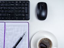 Office table desk. Workspace with blank note book, keyboard, office supplies and coffee cup on white background. Office table desk. Workspace with blank note royalty free stock photography