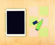 Office table with digital tablet, highlighter and sticky notes. View from above Stock Photography
