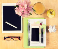 Office table with digital tablet, smartphone, reading glasses and healthy breakfast. View from above Stock Photography
