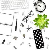 Office table Flat lay Keyboard notebook supplies clock succulent Royalty Free Stock Photography