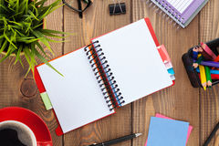 Office table with flower, blank notepad and coffee cup Stock Images