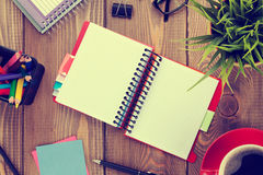 Office table with flower, blank notepad and coffee cup Stock Image
