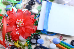 Office table with flower, blank notepad and colorful pencils Stock Photography
