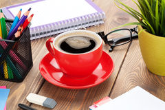 Office table with flower, supplies and coffee cup Stock Images