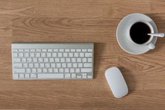 Office table with keyboard computer and coffee cup and Computer Stock Photography