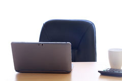 Office table with laptop and coffee cup Royalty Free Stock Photos