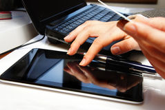 Office table with laptop and female hands Royalty Free Stock Photo